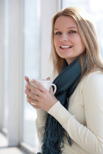 portrait of young woman holding cup : Stock Photo