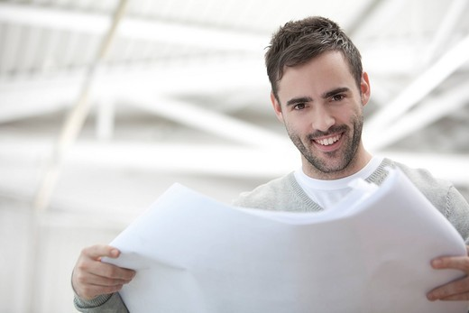 portrait of young businessman holding document : Stock Photo