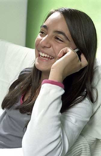 laughing girl with mobile phone : Stock Photo