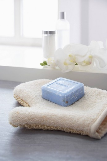 still life of washcloth and piece of soap : Stock Photo