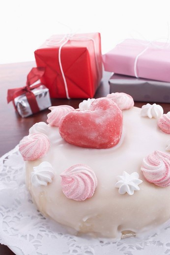 Stock Photo: 1669R-17593 still life of birthday cake decorated with hearts