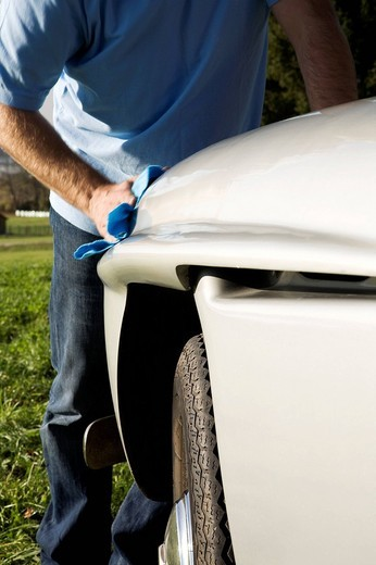man polishing his classic car with cloth : Stock Photo