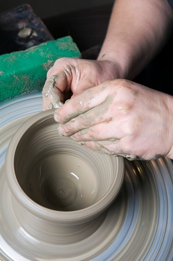 detail of potter forming jar on potter´s wheel : Stock Photo