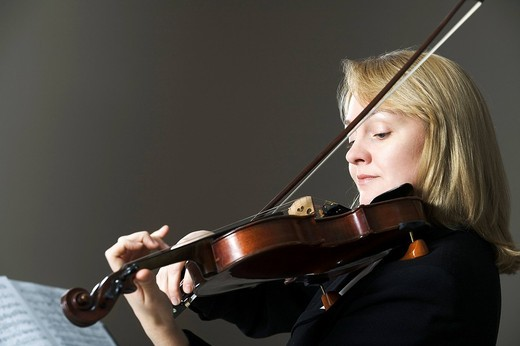 portrait of woman playing violin : Stock Photo