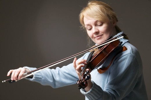 portrait of blond woman playing violin : Stock Photo