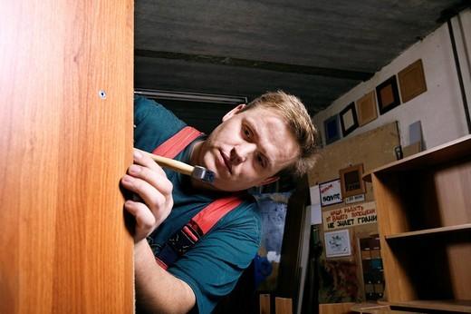 Stock Photo: 1669R-18018 portrait of craftsman assembling furniture in workshop