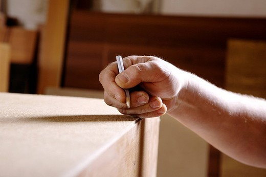 detail of craftsman making marking with pencil : Stock Photo