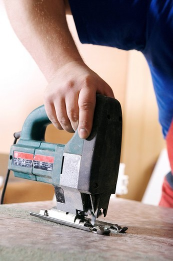 detail of craftsman cutting wood with jigsaw : Stock Photo