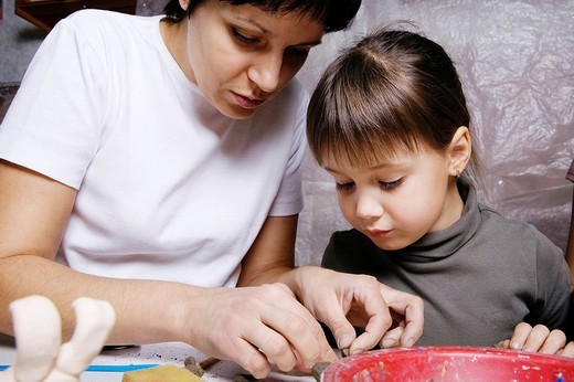 Stock Photo: 1669R-18061 mother and daughter forming sculpture out of clay together