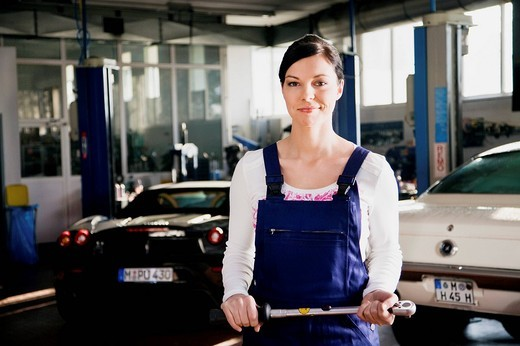 Stock Photo: 1669R-18185 portrait of female mechanic in garage