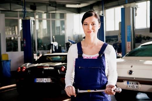 portrait of female mechanic in garage : Stock Photo