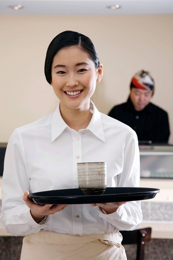 portrait of young japanese waitress : Stock Photo