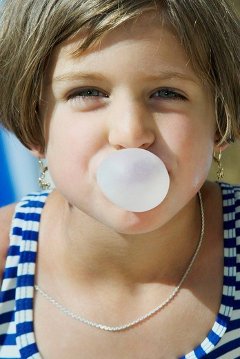 young girl blowing bubblegum : Stock Photo