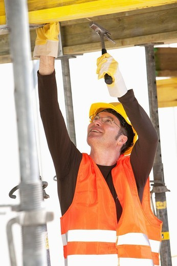 construction worker using hammer : Stock Photo