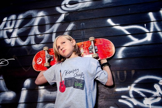 portrait of young boy with skateboard : Stock Photo