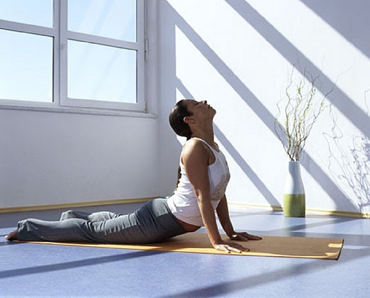 Stock Photo: 1669R-2135 Woman doing yoga, performing the cobra pose
