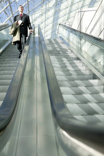 businessman on escalator : Stock Photo