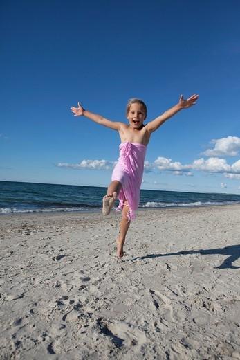 young girl having fun on beach : Stock Photo