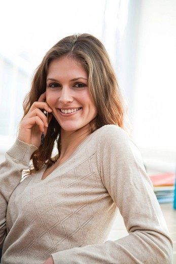 Stock Photo: 1669R-31765 portrait of young businesswoman talking on mobile phone