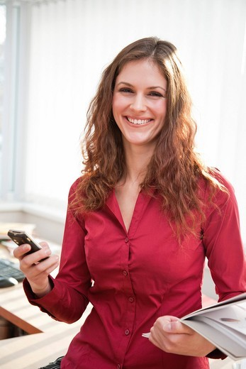 portrait of young businesswoman with mobile phone : Stock Photo