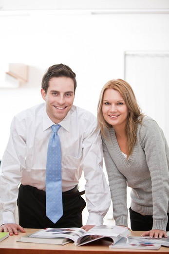 portrait of young businessman with female colleague : Stock Photo