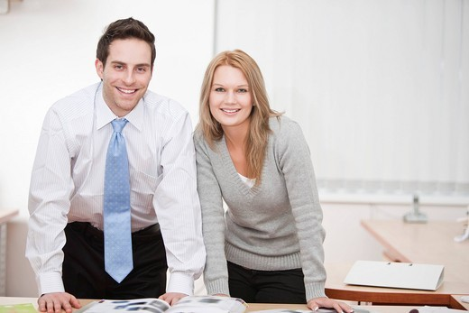 Stock Photo: 1669R-31817 portrait of young businessman with female colleague