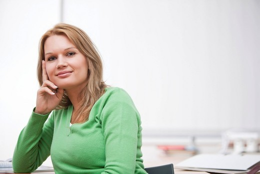 portrait of young businesswoman at desk : Stock Photo