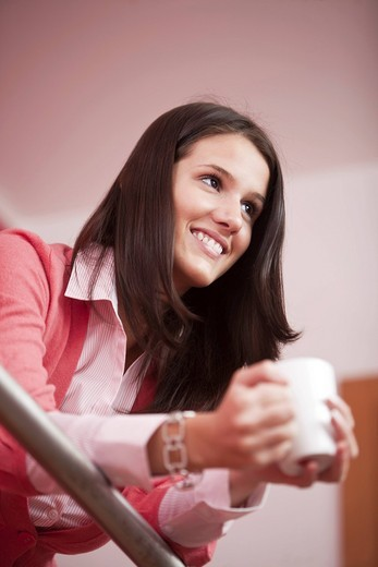 Stock Photo: 1669R-31837 portrait of young woman having coffee break