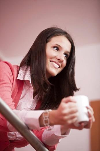 portrait of young woman having coffee break : Stock Photo