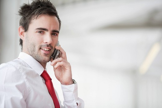 Stock Photo: 1669R-31881 portrait of young businessman talking on mobile phone