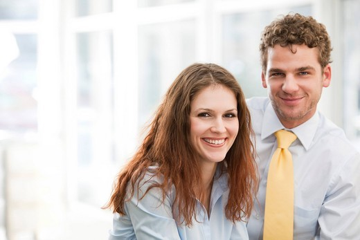 portrait of young businesswoman and male colleague : Stock Photo