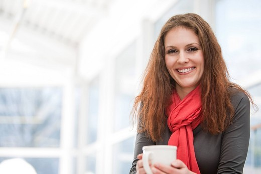 portrait of young businesswoman holding cup : Stock Photo
