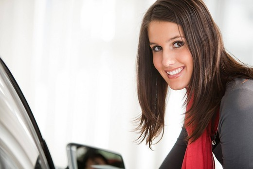 Stock Photo: 1669R-31966 portrait of young woman at car dealer