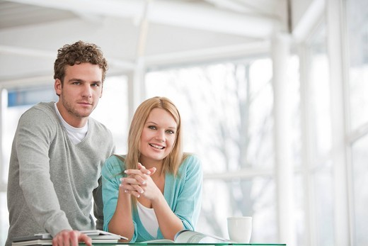 Stock Photo: 1669R-31998 portrait of young businesswoman and male colleague