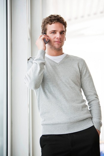 portrait of young businessman talking on mobile phone : Stock Photo