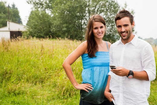 portrait of young couple with mobile phone : Stock Photo