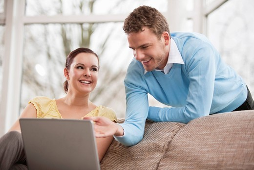 portrait of young couple with laptop computer at home : Stock Photo