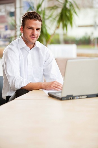 portrait of young man with laptop computer : Stock Photo