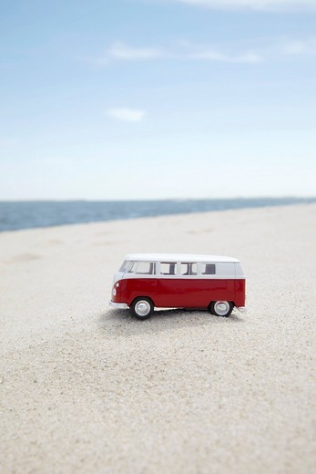 Stock Photo: 1669R-32574 vw toy car on sandy beach