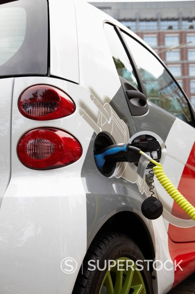 Stock Photo: 1669R-32636 electric car being recharged