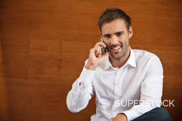 Stock Photo: 1669R-32764 portrait of young man talking on mobile phone
