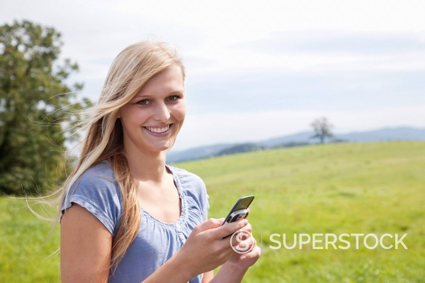Stock Photo: 1669R-32789 portrait of young woman with mobile phone