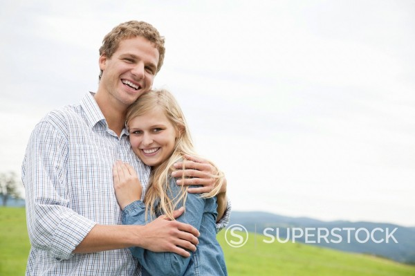 portrait of young couple on meadow : Stock Photo