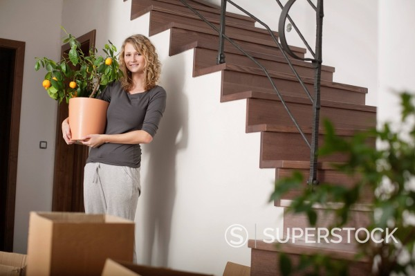 Stock Photo: 1669R-32996 portrait of young woman in new home