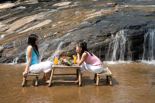 Thailand, Chiang Mai. Thai women relaxing outdoors : Stock Photo