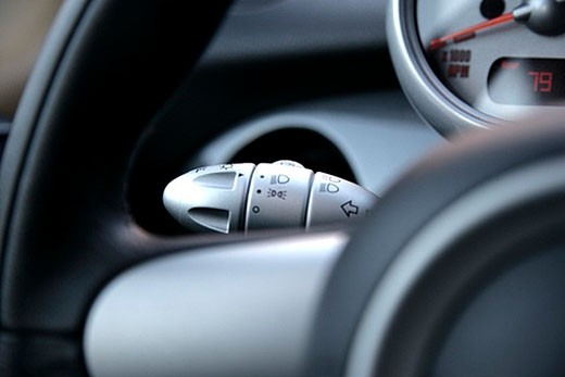 Stock Photo: 1669R-4185 close-up of turn signal indicator switch, light switch and other controls in car