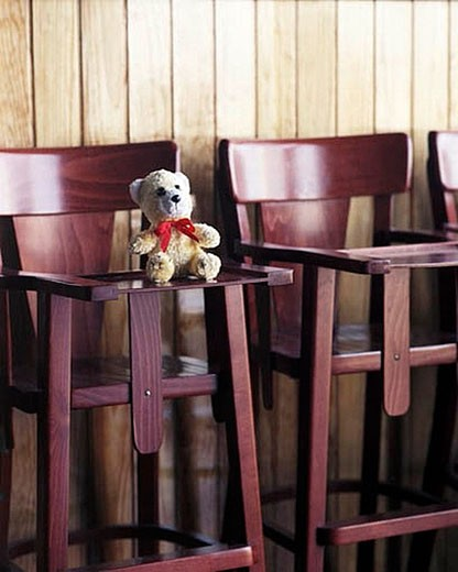 teddy bear on high chair in restaurant : Stock Photo
