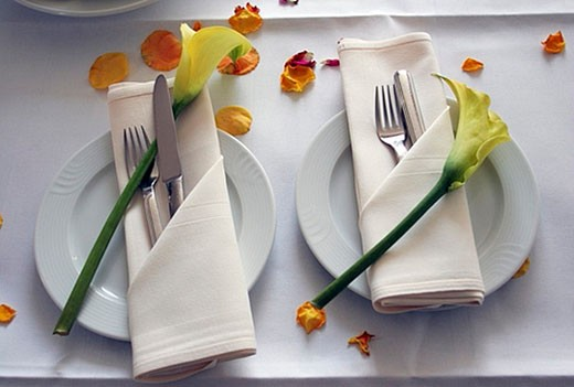 still life of table setting for a festive meal with flower petals : Stock Photo