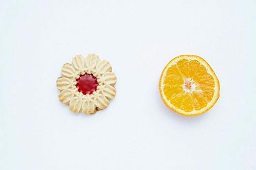 still life of cookie and piece of orange : Stock Photo