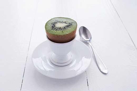 still life of kiwi fruit in eggcup : Stock Photo